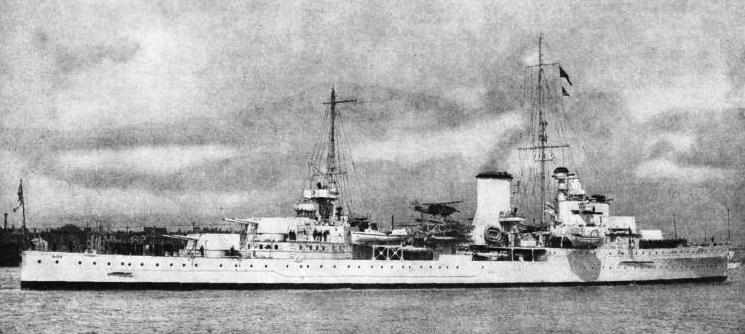 H.M.S. AJAX. This ship has a displacement of 7,030 tons, an overall length of 554½ ft and a beam of 55 ft 2-in