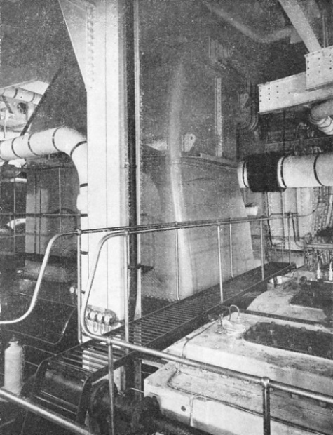 THE GIANT EXHAUST TRUNKING from one of the low-pressure turbines in the Queen Mary's main engine-room