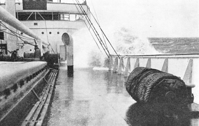 A HEAVY SEA coming aboard the foredeck of the Pennyworth