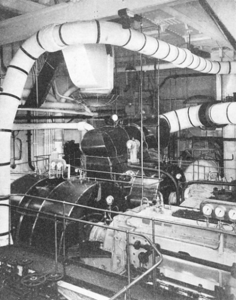 TWO OF THE TURBINE CASINGS in the Queen Mary's after engine-room