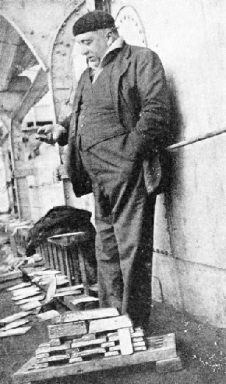 Commendatore Quaglia is seen standing by the first gold bars recovered. A few hours later bullion worth £80,000 was picked up.