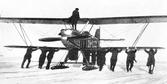 AN ARCTIC AEROPLANE is specially fitted with skis for landing on the ice and snow.