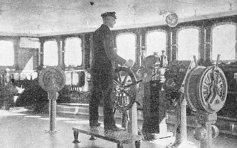 The helmsman in the wheel-house of the Bremen