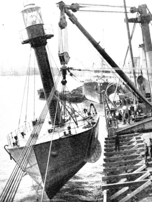 The Belmoira off Woolwich lifting on board a complete lightship