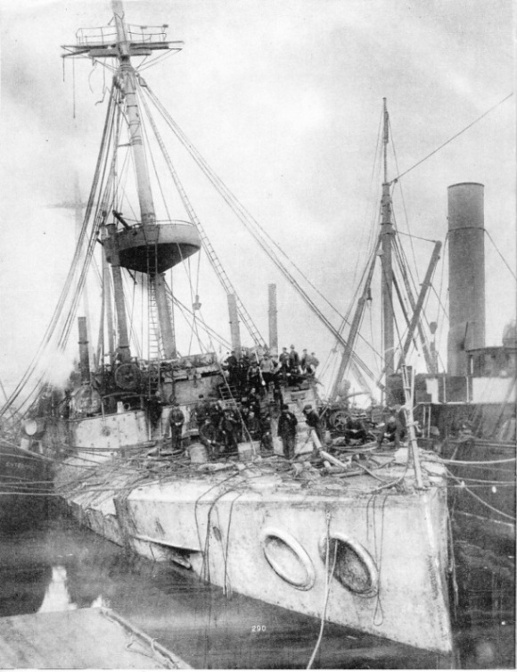 The cruiser Gladiator, supported by salvage tugs