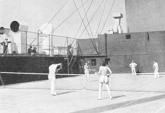TENNIS ENTHUSIASTS travelling in the Empress of Britain have a full-sized tennis court
