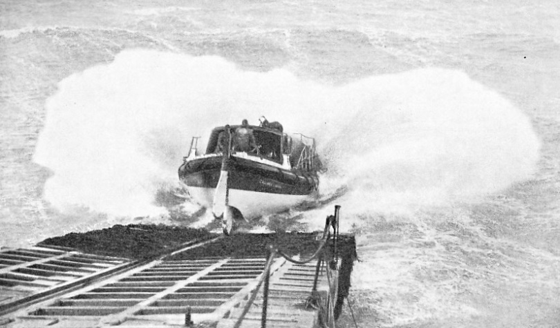 A spectacular picture of the Cromer motor lifeboat being launched