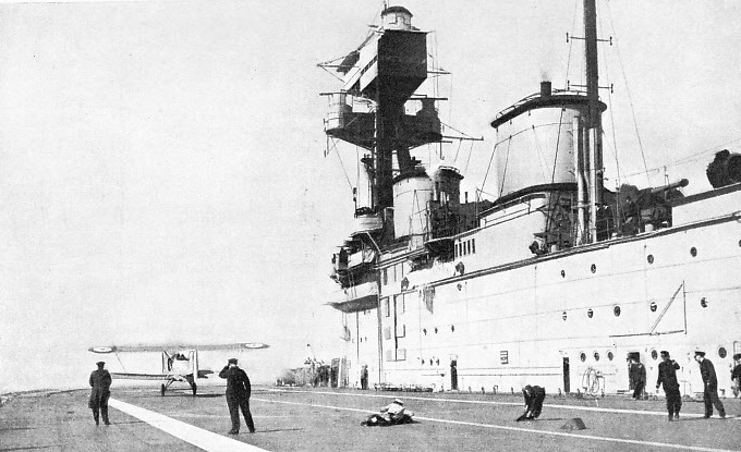 THE FLIGHT DECK OF H.M.S. EAGLE, showing the bridge and funnel